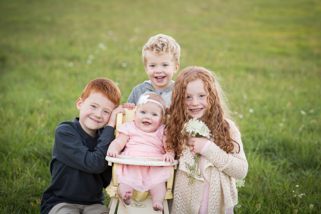 Family portrait 4 kids in field